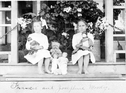 Francis and Josephine Moody sit with their dolls on Mrs. Fairbanks porch (possibly in Santa Rosa)