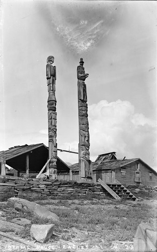 Eagle and eagle and man totems (man is wearing stovetop hat), Alaska. [negative]
