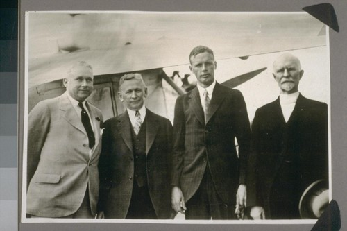 Reading from left to right - Hon. A.E. Goddard, Mayor of Sacramento City, Cal., Hon. C.C. Young, Governor of the State of Cal., Col. C.A. Lindbergh, Pioneer of Air Transportation, John E. Lonergan, Pioneer of Rail Transportation in Cal