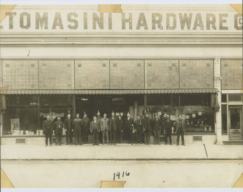 Group of employees standing outside of the A. F. Tomasini Hardware stores at 120 Kentucky Street, Petaluma, California in 1916