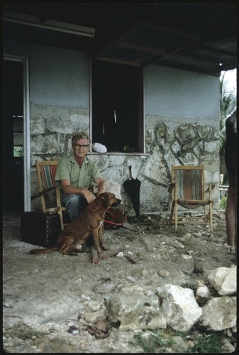 Father Laughman in a chair in front of his house