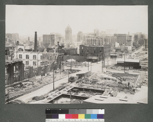 [South of Market area during reconstruction. View north along Secon St. Call Building, left center; Fairmont Hotel in distance, right center.]