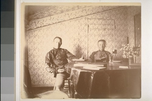 [Two unidentified Chinese men]
