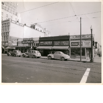 North side of 12th Street between Webster and Franklin Streets, April 1949