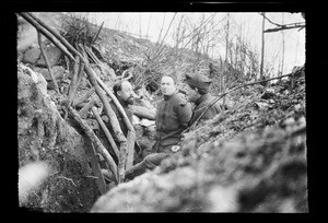 Three soldiers smoking pipes in a trench during World War I, ca.1916