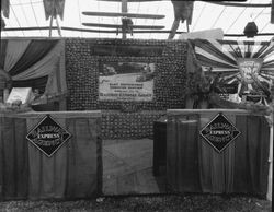 Gravenstein Apple Show, about 1930, with a display of Railway Express Agency and a sign for the National Automobile Club