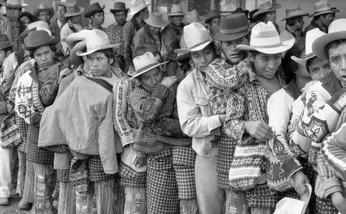 Mayan men wait in line to vote, Guatemala City, 1982