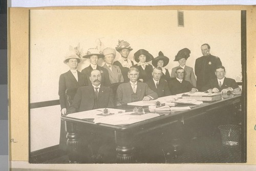 Seated at table L to R: J. Spiro, Jesse B. Cook, Pres. J. Woods, Alex O'Grady, Sect. Chas. Skelly. Chief White standing