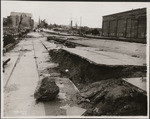 [Subsidence of street and sidewalk along Capp St.]