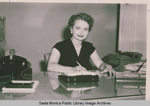 A woman sitting behind a desk in an office, Pacific Palisades, Calif