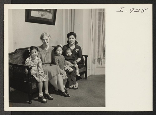 Mrs. K. Sasaki, formerly from Minidoka, poses for her picture with her three children and Miss Alice Finley, hostel director