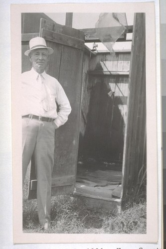 July, 1936, Kern County, Kern Lake District. Banducci Ranch. Shower. Note the broken, littered-up floor, absence of any dressing quarters, and only cold water for the shower. The drain resulted in a mud hole forming in front of the door. The only shower available for the laborers and their families from several cabins