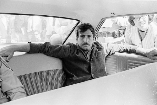 Jack Weinberg in the back seat of the police car