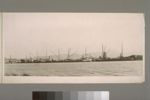 Fleet of lumber schooners at dock of Redwood Mnfrs [Redwood Manufacturers] Co. Pittsburg, Calif. Lumber was brought from mills along the coast