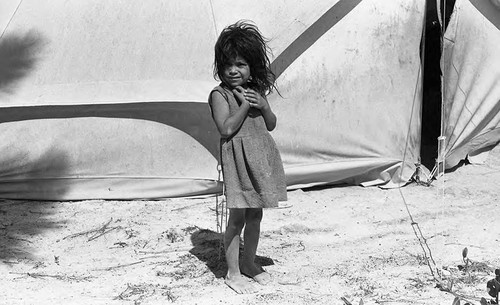 Refugee girl outside of a tent, Morazán, 1983