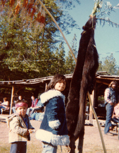 Two children looking at bear skin--(Bear Dance--Janesville--1980)