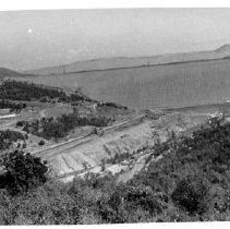 Wide view of the nearly-completed Oroville Dam and reservoir