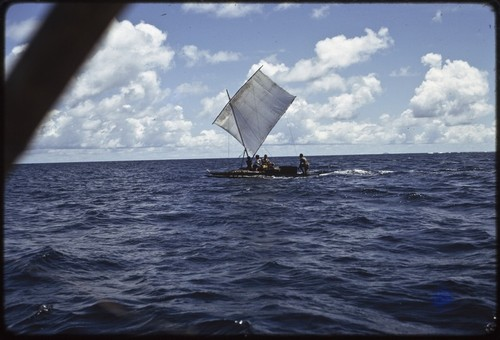 Manus: sailing canoe in open ocean near Pere village, sail up