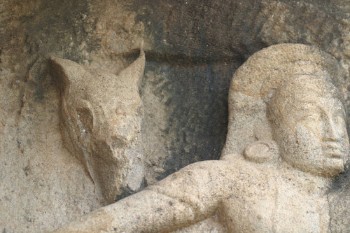 Isurumuniya, rock temple: north of shrine: sculpture of seated man and a horse