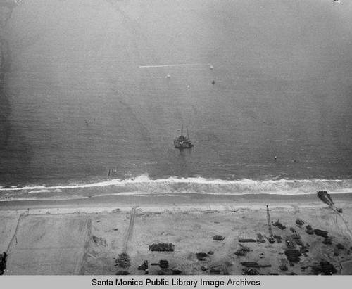 Remains of Pacific Ocean Park pier looking west to the barge in Santa Monica Bay, July 10, 1975, 2:30 PM