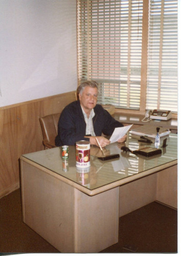 Donald O. Hallberg sitting at his desk at the office of O. A. Hallberg & Sons at 2999 Bowen Avenue, Graton, March, 1983