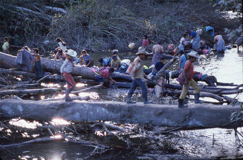 Guatemalan refugee women and children wash themselves and their clothes in the rive, Puerto Rico, 1983