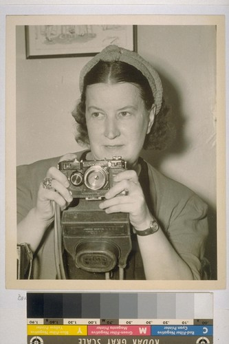 [Therese Bonney with camera.]
