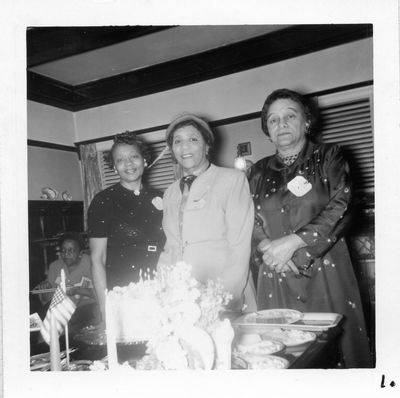 Chlora Hayes Sledge (center) and two unidentified women standing next to banquet table