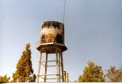 Water tower and tank at O. A. Hallberg & Sons cannery, September, 1979