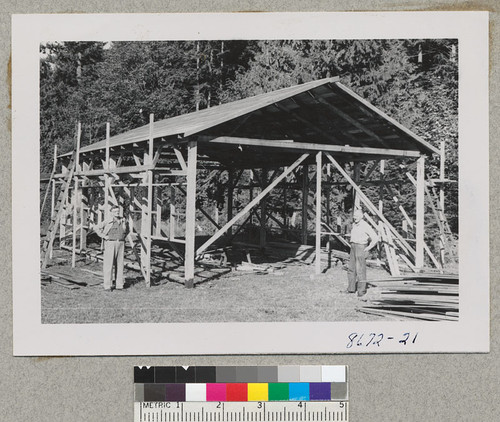 Herb Plumb & Carl Nordstrom, Issaquah, Wash. Framework for a barn Carl is building. Metcalf. Sept. 1952