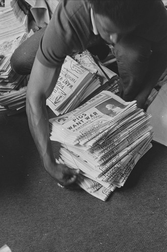 Getting the Black Panther newspaper ready for national distribution, Black Panther National headquarters, Berkeley, CA, #104 from A Photographic Essay on The Black Panthers