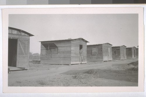 July, 1936, Kern County, Kern Lake District. Row of cabins for farm laborers
