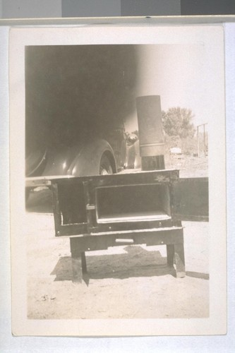 Spring, 1935, Hooverville, Kern County. On highway north of Bakersfield. Hand made camp stove. (See other picture)
