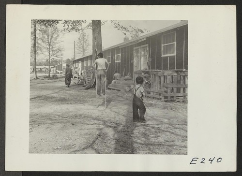 A street scene in block 7 on a November afternoon. Photographer: Parker, Tom Denson, Arkansas