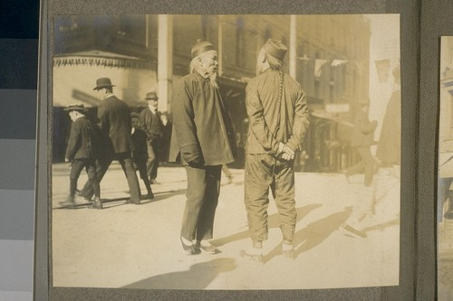 [Street scene, Chinatown. Unidentified men.]