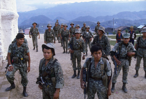 A group of soldiers standing in front a church, Chajul, 1982