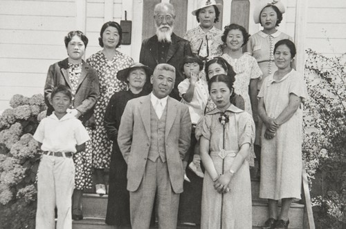 Japanese Methodist Church, A Street, Oxnard : 1937. Clockwise from far left around outside: Calvin Machida, Mrs. Yasuye Takasugi, Mrs. Machida, Rev. K Babu (founder and first minister of church), Mrs. Yamada, Faye Hirata, Tsuruka Yamada, Mrs. Kawata, Mrs. Mano & Mr. Mano. In middle on left: Mrs. Otani (wearing hat), woman holding child not identified