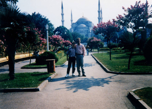 Father and son in front of mosque
