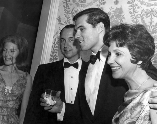 John Gavin with Mr. and Mrs. Tom Sarnoff