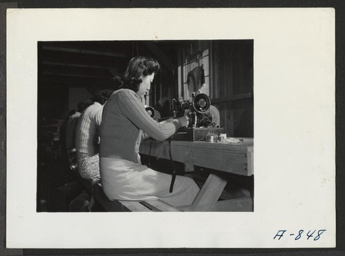 Sewing school. Evacuee students are taught here not only to design but make clothing as well. Photographer: Stewart, Francis Poston, Arizona