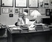 de Forest at his desk, facing right