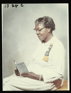 Caroline Punch reading a COGIC book, Texas