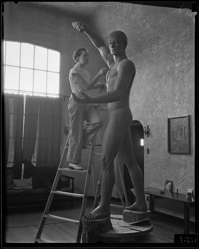 Nina Saemundsson working on her statue of Prometheus Bringing Fire to Earth in her studio, Los Angeles, 1934