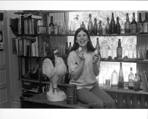Suzy Mannion and bottle collection of Ed Mannion