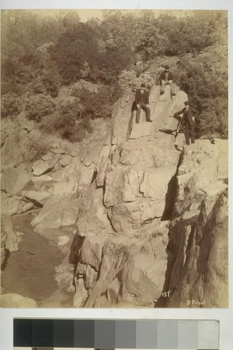 157. D. Fricot. [Unidentified men on rocks. Deer Creek?]