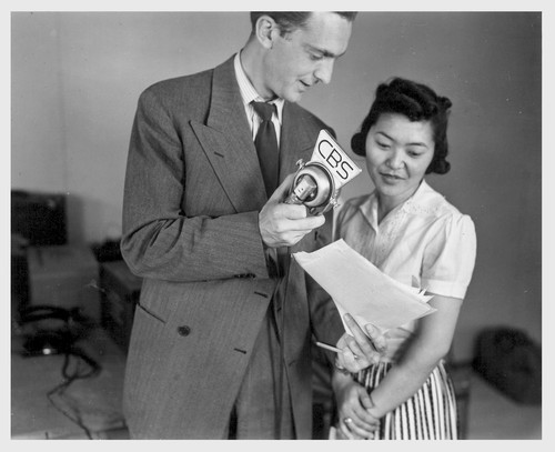 Poston, Ariz.--Florence Mori, evacuee of Japanese ancestry at this War Relocation Authority center, taking part in this CBS broadcast. Chet Huntley of the CBS is directing the program.--Photographer: Clark, Fred--Poston, Arizona. 5/26/42