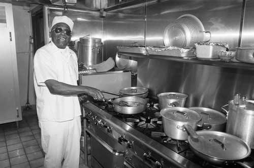 Ciro's Restaurant chef posing at the kitchen stove, Los Angeles, 1987