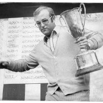 Pro golfer Vic Loustalot of Sacramento clutches the trophy for winning the Northern California Open golf tournament