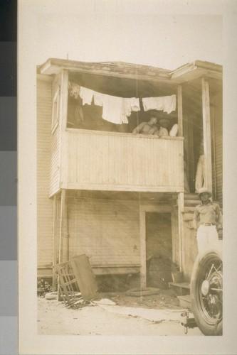 Snapshots of laborers and buildings, location unknown