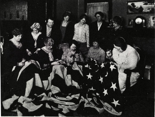 Thimble Club of Glendale Women's Auxiliary repairing flag, 1929